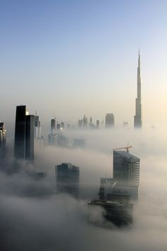 The tip of the #BurjKhalifa and other skyscrapers in #Dubai beyond the clouds.