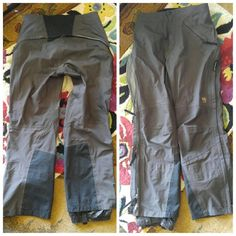 ❄Mountain Hardwear Conduit Snow/Ski/Shell Pant Good used condition with signs of wear. Photo 3 shows superficial wear/abrasion under knees and at ankles. A few spots that may or may not be stains, most obvious is under front pocket, photo 4.  Excellent layer, with full length back ventilation options, due to multiple zipper pulls along same track, from ankle to and across back hips tho other ankle. You can vent anywhere and any amount you like.  These are BLACK, but sunlight makes them look…