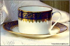 Stylish and classic Porcelaine de LIMOGES cup and saucer duo in Royal Blue and White with refined gilded lase pattern - en exquisite addition to your dining table or tea cup collection to make a truly Royal statement of refined style.