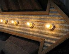 corrugated iron arrow - leading to bar