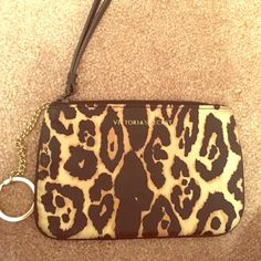 Wristlet from Victoria secret Brown and black cheetah print. Comes with keychain on side and never used! PINK Victoria's Secret Bags Clutches & Wristlets