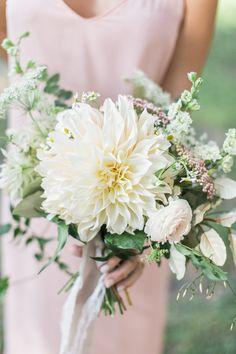 pink bridesmaids dress and dahlia wedding bouquet