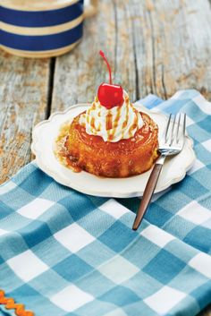 Our Pineapple Upside Cake is a buttery white cake with caramelized pineapple slice, whipped cream, maple whiskey caramel sauce and of course a cheery on top