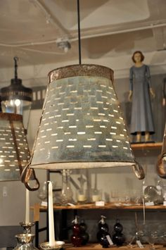 love the rustic vintage style of this lamp (Pierced light bucket from Go Home via Velvet and Linen blog)