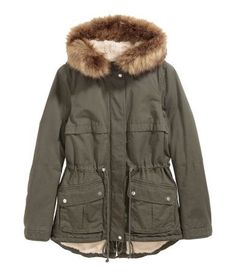 Dark khaki green. Lightly padded parka in cotton twill with pile-lined hood with detachable faux fur trim. Zip and wind flap at front with snap fasteners,