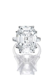 Diamond ring by Van Cleef & Arpels. Set with a cut-cornered rectangular step-cut diamond weighing 16.27 carats, between tapered baguette diamond shoulders, mounted in platinum, size 53, signed Van Cleef & Arpels and numbered, French assay and maker's marks.