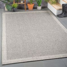 Relax and enjoy this expertly crafted Felipe Charcoal Indoor/Outdoor Area Rug. Composed of polypropylene fibers that are softer than jute and have a great natural feel. Classic solid with texture for a timeless look. Pairs well with Farmhouse and Industrial decorating styles as well! Great for patio, deck, outdoor room, sunroom, basement, family room, or anywhere you want the simple look of jute. Naturally stain-resistant and may be cleaned with mild detergent and water; allow to dry tho...