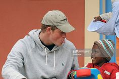 Prince Harry sticks out his tongue as he jokes with a child during a visit to the Lesotho Child Counselling Unit on July 9, 2008 in Maseru, Lesotho. The Prince's charity Sentebale works with the LCCU to provide a safe house for abused children
