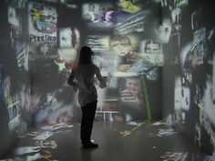 This is another example of virtual art. In this image it shows a bunch of different photos reflecting on the walls from a projector. This shows how new media has impacted the arts because we are able to present art through technology.