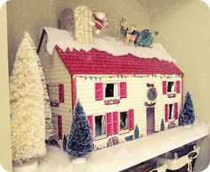 Vintage metal dollhouse decorated for Christmas- love the Santa & reindeer on the roof top