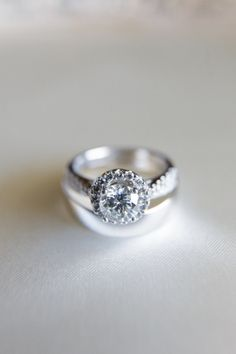 Simple diamond halo engagement ring.
