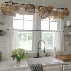 Wanted to try something fun and different with my old basket collection. I've seen straw hat collections as window valances so why not baskets. I couldn't be happier with it! Farmhouse Baskets, Kitchen Baskets, Old Baskets, Vintage Baskets, Farmhouse Decor, Picnic Baskets, Wicker Baskets, Primitive Kitchen Decor, Kitchen Window Valances