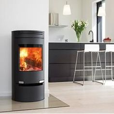 Aduro with Drawer - Black Soapstone Wood Burning Stove, Aduro Wood Burning Stoves, by Aduro Wood Burning Stoves, Aduro with Drawer - Black Soapstone Wood Burning Stove Aduro 1 can also be supplied clad in Finnish soapstone tiles on th. Soapstone Tile, Fireplace Hearth, Curved Glass, Piece A Vivre, Round Design, Herd, Living Room With Fireplace, Tile Design, Wood Burning