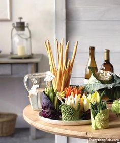 Elegant veggie tray idea, wrap cabbage leaves around glass jars.