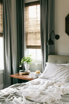 grey green window treatments and wall sconces above the bed. It is best to have multiple sources of light in a bedroom rather than one bright one. Always put sconces on dimmers!
