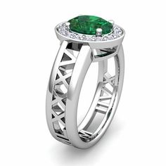 Custom Halo Gemstone Engagement Ring in Roman Numeral Band - shown in white gold with an emerald surrounded by a halo of white diamonds