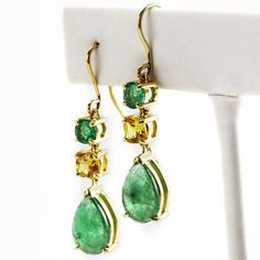 Emerald and Sapphire Earrings 18 Yellow Gold. French Wire Earrings are handmade using faceted and rustic emeralds and yellow sapphires. #65allure #emerald #sapphire #jewelry #frenchwire #earrings