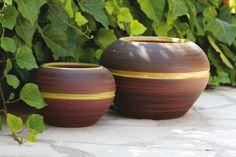 Ceci sont des pots en terre que j'ai fait en poterie.