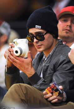Zac Efron attends the Los Angeles Lakers vs Minnesota Timberwolves NBA game at Staples Center ~ December 20, 2013