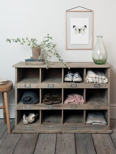 Made from hand selected spruce wood that is both robust and hardwearing, our Large Wooden Box Unit is inspired by old fashioned shoe lockers and matches our best-selling Low Wooden Box Unit. Perfect for the utility room or hallway, each unit includes twelve cubby holes with metal-framed label slots that are great for giving shoes and hallway clutter a new home. Why not add cushions to the top and transform into a handy bench for changing your shoes?  This item comes to you directly from…