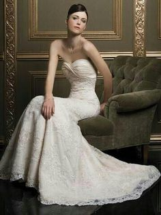 Beautiful, beaded lace wedding gown, with twisted sweetheart neckline.