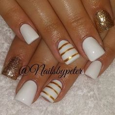 White and gold nail art design in minimalist design. The nails are designed in stripes of gold as well as gold glitter. The design is simple yet at the same time easy on the eyes.