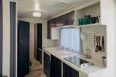 Mobil Home de alquiler en el camping situado en la Costa Dorada. Cabinet, Navy, Storage, Furniture, Home Decor, Camper Van, Clothes Stand, Hale Navy, Purse Storage