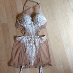 I just discovered this while shopping on Poshmark: NWOT beautiful Victoria's Secret mini dress. Nude.. Check it out! Price: $59 Size: 36B