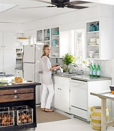 The cost of this kitchen reno? A whopping $31 -- spent mostly on white paint! Love the pops of turquoise.