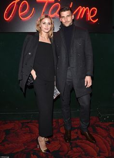 Never a fashion fail: Olivia Palermo and Johannes Huebl also joined the fray, where they cut stylish figures