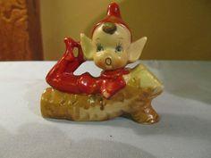 Vintage Red Elf Pixie on Log