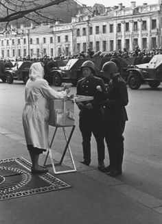 Soldiers buy ice cream at a Moscow May Day Parade, 1950