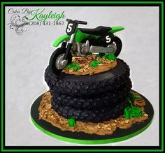 """Dirt bike birthday cake.  Fondant dirt bike topper on top of 8"""" round tire cake.  To check out more of my work check out my facebook page at https//:www.facebook.com/cakesbykayleighboesiger"""