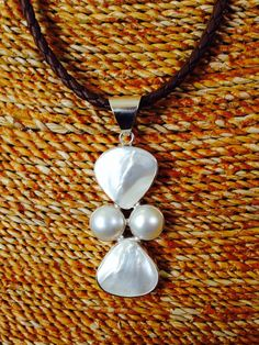 Let's get real... Mother of pearl and Mabe pearl pendant.. find it on.. https://www.etsy.com/listing/206209862/real-pearl-pendant-combination-of-mother?