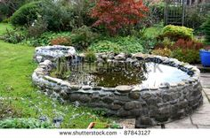 Stone Duck Pond - on a slope so you can easily attach a spout for draining water to use in the garden