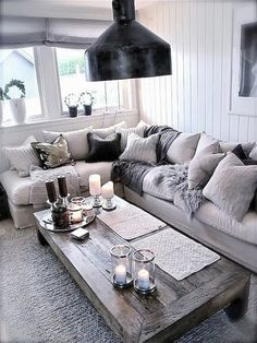 Totally swooning over this cozy chic living room! The different shades of grey a. Totally swooning over this cozy chic living room! The different shades of grey against a light couch brings a modern twist to your home decor. Home And Living, Family Living Rooms, Cozy Living Rooms, Cozy House, Living Room Designs, Chic Living Room, Living Decor, Silver Living Room, Living Room Grey