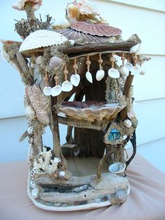 Mermaid beach dollhouse or decoration  shells sea fans  blue glass ball. $275.00, via Etsy.