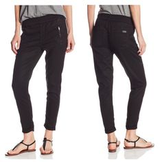 NWOT 7 For All Mankind soft pant with cuffed hem Brand new and never worn. Lyocell, Cotton, and Spandex black soft pants with cuffed hem. Elastic waistband. Back pockets. No PP or trades. Size 26. Will consider offers. 7 for all Mankind Pants Ankle & Cropped