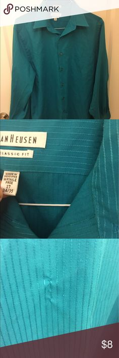 Men's dress shirt Men's teal dress shirt. The back of the shirt has a small barely noticeable run in the material which I took a picture of. But good to wear under a vest or jacket for work/an interview. Van Heusen Shirts Dress Shirts