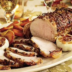 Rosemary-Garlic Pork With Roasted Vegetables and Caramelized Apples - Best Apple Recipes - Southern Living