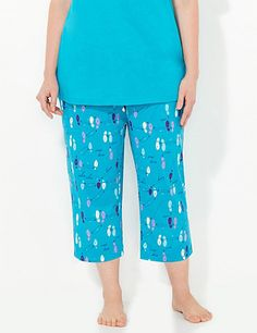 "Our playful sleep capri is covered in a fun, numbered-dance-step print with the text ""cha-cha"" and ""two left feet"" spread throughout. Pairs perfectly with our Beautysleep Sleep Tee for a coordinating look. Elastic waist. Side pockets. For your comfort, Catherines sleepwear has been made specifically for the plus size figure. catherines.com"