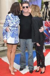 Amanda Holden and Alesha Dixon share a lesbian kiss on 'Britain's Got Talent'. Alisha Dixon, Britain's Got Talent, Amanda Holden, Lesbians Kissing, Simon Cowell, Vera Bradley Backpack, Hot, How To Wear, Buns