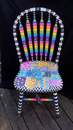 Brightly painted furniture...My Happy Chair makeover http://mysingingheartart.blogspot.com/2015/05/ugly-chair-makeoverfrom-ugly-to-happy.html