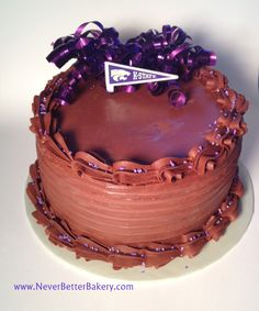 Chocolate Cake with Purple Ribbon and K-State Pennant. One of our signature cakes.