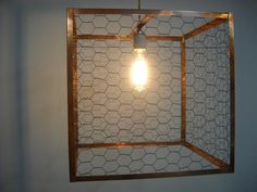 Hanging Rustic Industrial Lighting made from Chicken Wire and Copper - Bare Bulb Fixture - Made to Order. $495.00, via Etsy.