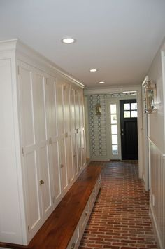 Absolute dream mudroom.  Love the wallpaper, the sconce, the floor, the millwork- dreamy!