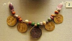 6-7c Bead necklace with meillefiori and gold coin pendants, Anglo-Saxon under the Byzantine influence. British Museum