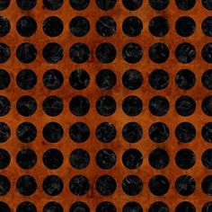 A pattern of black marble circles with a brown burled wood background.
