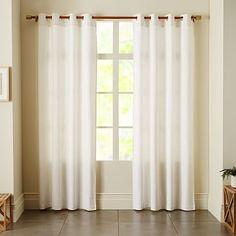 Linen Cotton Grommet Curtain - White.  Featured in Chrislovesjulia livingroom