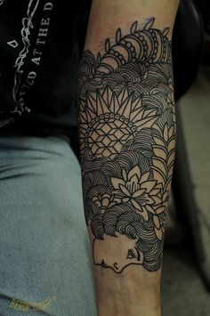 I think I would prefer it without the face, but either way, it's a beautiful sleeve tattoo
